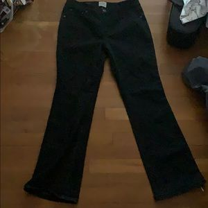 Black bootcut style jeans. No signs of wear.